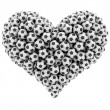 Heart shape composed of many soccer balls isolated on white — Stock Photo