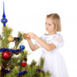 Nice girl decorates a Christmas tree — Stock Photo #2731699