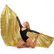 Dancer with golden wings on a white background. — Стоковая фотография