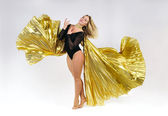 Dancer with golden wings — Stock Photo