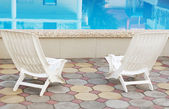 Swimming pool and resting chairs — Stock Photo