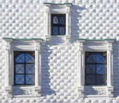 Window of old church with lattices and an ornament on it. — Stock Photo