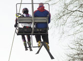 Move on ski-lift. Man and kid — Stock Photo