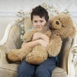 Boy with a bear — Stock Photo