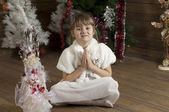 Young girl in New Year room — Stock Photo