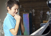 Boy is playing the piano — Foto Stock