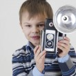 Kid with old camera — Stock Photo