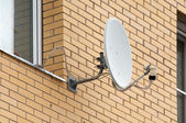 Sattelite antenna on a window — Stock Photo