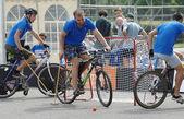 Three bicycle polo players — Stock Photo