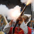 Shooting a musket — Stock Photo