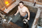 The man bathes in an ice-hole — Stock Photo