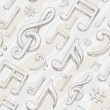 Vector seamless background with hand drawn treble clef and notes - Stock vektor