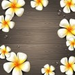 Tropical flowers and water drops on a wooden background - vector illustration - Stock Vector