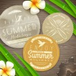 Vintage paper labels with vacation and travel emblems and tropical flowers on a wooden surface - vector illustration — Imagen vectorial