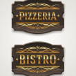 Vintage wooden signs for pizzeria and bistro with golden lettering and decorative elements - vector illustration — Stock Vector
