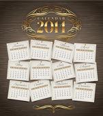 Vektor formgivningsmall - kalender 2014 med gyllene utsmyckade element på en trä bakgrund — Stockvektor