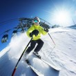 Stock Photo: Skier in mountains, prepared piste and sunny day