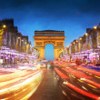Arc de triomphe Paris city at sunset - Arch of Triumph and Champs Elysees — Stock Photo