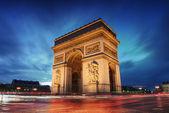 Arc de triomphe paris stad bij zonsondergang — Stockfoto