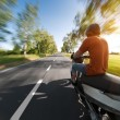 Rider on motorcycle riding in parkway — Stock Photo
