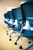 Meeting room, empty chairs and table — Stock Photo