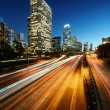 City of Los Angeles California at sunset with light trails — Foto de Stock