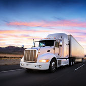 Truck and highway at sunset - transportation background — Stock Photo