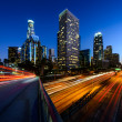 City of Los Angeles California at sunset with light trails — Stock Photo #39527863