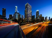 City of Los Angeles California at sunset with light trails — Stock Photo