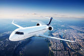 Private jet plane in the blue sky — Stok fotoğraf