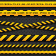 Police line and danger tapes on dark background — Vettoriale Stock #15867337