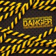 Danger sign under police lines and danger tapes — Stock vektor