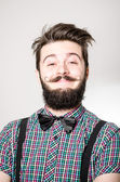 A young man with a nerdy look smiling at the camera — Stock Photo