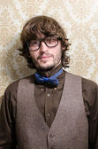Young bearded fashionable man with glasses and bowtie — Stock Photo