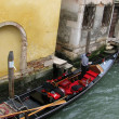 Venetian gondola and gondolier — Stock Photo
