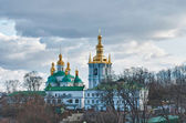 Monastery in Kiev under river Dnieper — Stock Photo