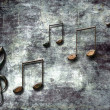 Abstract dark background with musical notes — Stock Photo #22290429
