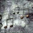 Stock Photo: Abstract dark background with musical notes