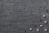 Metal rivets on the denim background — Stock Photo