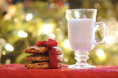 Cup of milk with cookies for Santa — Stock Photo