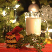 Milk with wrapped cookies for Santa Clause — Stock Photo