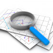 Business diagrams and magnify glass — Stock Photo