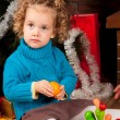 Little girl near Christmas tree — Stock Photo #7960794