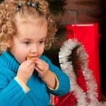 Little girl near Christmas tree — Stock Photo #7960833