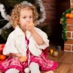 Preaty little girl eating tangerine — Stock Photo #7961035