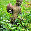 Girl statue in a garden-1 — Stock Photo