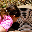 Looking down a manhole — Stock Photo