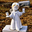 Stock Photo: Gravesite - Angel - blonde with candle holders
