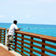 Men fishing on pier - Stock Photo