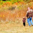 Royalty-Free Stock Photo: Father and Son walk down the hill